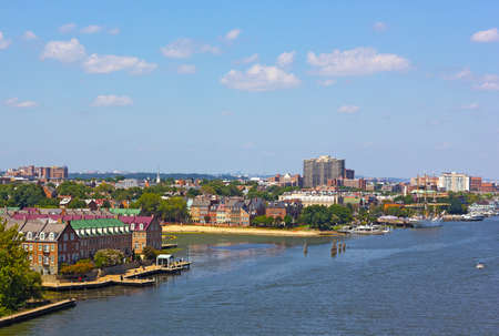 A view on old town Alexandria from the Woodrow Wilson Memorial Bridge, Virginia, USA. Potomac River panorama in early autumn. Reklamní fotografie - 91617823