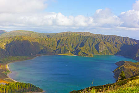 Aerial view of Lake Fogo, Sao Miguel Island, Azores, Portugal. Mountainous landscape of volcanic island with crater lake.