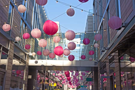 DC City Center festive spring atmosphere accompanies cherry blossom events in Washington DC, USA. City Center features boutiques and restaurants along pedestrian alley brighten by pastel colored balloons.