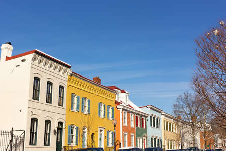 Brightly painted houses on the street of Washington DC neighborhood, USA. Residential houses in close proximity to the Georgetown University.