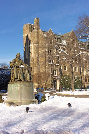 WASHINGTON DC, USA - JANUARY 15, 2019: Georgetown University campus main square with statue of its founder John Carroll on a wintry day after a heavy snowfall. Editöryel