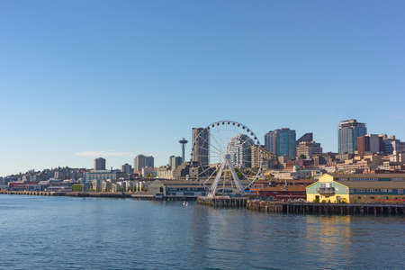 A view on Seattle city from the Puget Sound bay waters, USA. Cityscape on a sunny afternoon in summer.