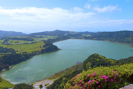Lake Furnas (Lagoa das Furnas) on Sao Miguel Island, Azores, Portugal. A view of the lake from the Pico do Ferro scenic overlook during azaleas bloom.