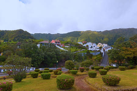Furnas landscape of Sao Miguel Island, Azores, Portugal. Hilly landscape with meadows, fields and forest.
