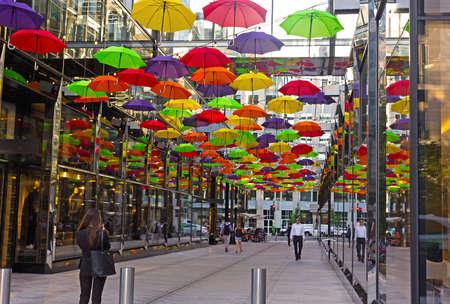 WASHINGTON DC, USA – SEPTEMBER 19, 2018: Pedestrian alley under colorful umbrellas in Washington DC downtown.