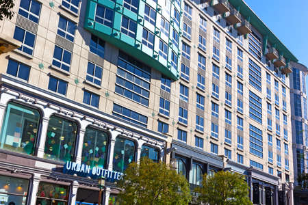 WASHINGTON DC, USA – OCTOBER 30, 2018: Residences at Gallery Place building with luxury condos at the heart of Gallery Place – Chinatown area in autumn. The building has a theatre and multiple shops on the street level.