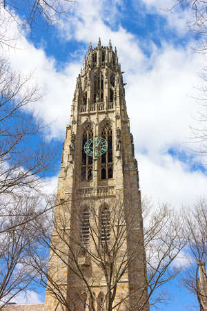 NEW HAVEN, CONNECTICUT, USA - APRIL 8: Harkness Tower at Yale University as seen on April 8, 2017. The structure is a masonry tower built in English Perpendicular Gothic style.
