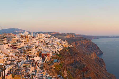 Sunset over Fira on Santorini Island in Greece.