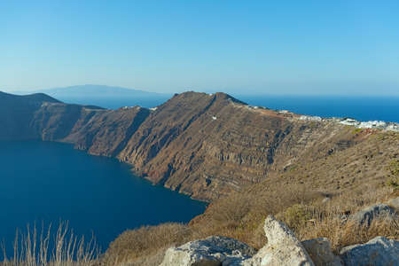 Caldera in Aegean Sea surrounded by gigantic cliffs of Santorini Island, Greece. Фото со стока