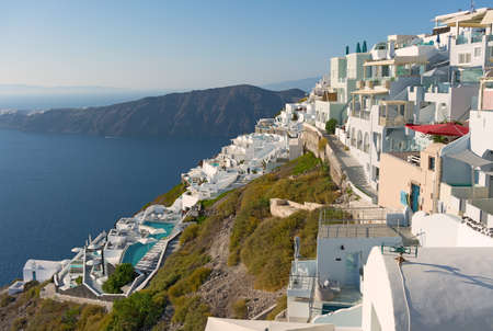 Traditional whitewashed buildings on a cliff of Santorini Island, Cyclades, Greece. Фото со стока