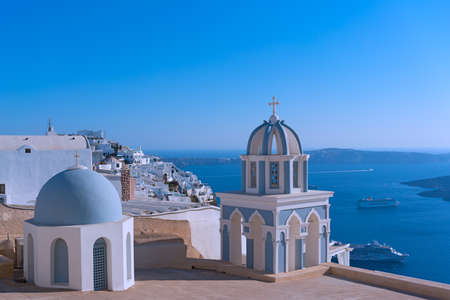 Church on a cliff overlooking Aegean Sea, Santorini Island, Greece.
