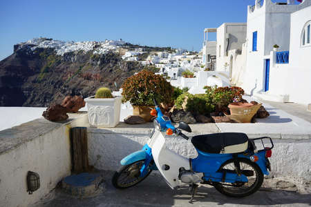 Traditional cubical houses and motorbike of Santorini Island, Greece.