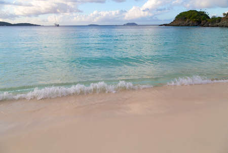 A view on Caribbean Sea from the Trunk Bay beach at sunset, St John Island, US Virgin Islands. Фото со стока