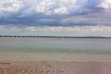 Vasco da Gama bridge on cloudy day in autumn in Lisbon, Portugal. The longest European bridge across Tagus River.