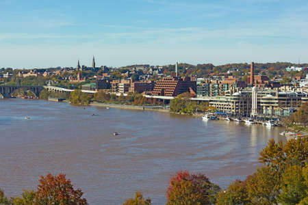 Georgetown Park and river waterfront of Washington DC, USA in autumn. Beautiful landscape of Potomac River near Key Bridge in US capital.