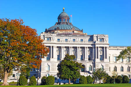 Thomas Jefferson Building is a part of the United States Library of Congress in Washington DC, USA. The Beaux-Arts style of historic building under blue skies in autumn. Editöryel