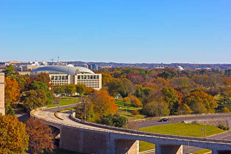 Washington DC panorama as seen from the Potomac River waterfront building in autumn. Park zone around US capital city downdown.