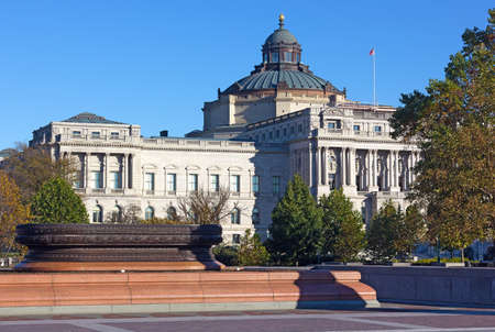 The west facade of the Thomas Jefferson Building of United States Library of Congress in autumn. The oldest of the four United States Library of Congress buildings under blue skies.
