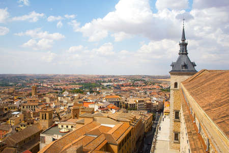 Panorama of Toledo, Spain. The old historical city of Toledo under blue sky with cumulus cloud.