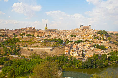 Toledo city panorama, Spain.The historic city of Toledo with river Tajo under blue sky with cumulus clouds.