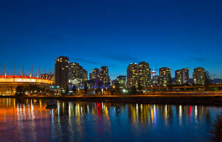 Vancouver city skyline at night, Brithish Columbia, Canada. Colorful reflections of city buildinsg in False Creek.