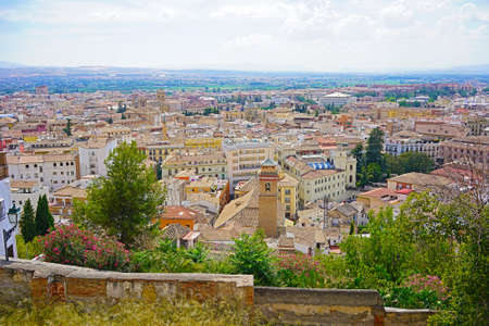 Panoramic view from the city evevated point on old town of Granada and mountains on horizon, Spain. Historic and modern buildings in close proximity to each other in urban settings. Stok Fotoğraf