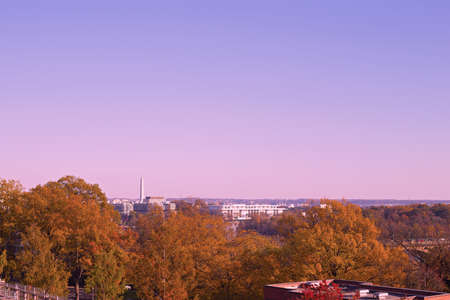 Washington DC panorama with Potomac River at sunset. Colorful autumn colors in Georgetown neighborhood under clear sunset skies. Stok Fotoğraf