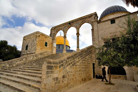 Artistic view of the Golden Dome Mosque with arches (Jerusalem, Israel) photo