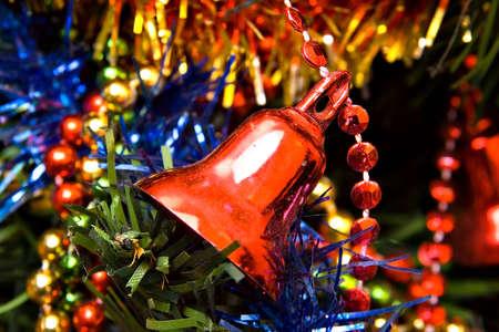 Christmas bell on tree Stock Photo
