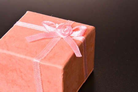 Pink gift on black ISOLATED Stock Photo