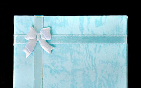 Blue gift on black ISOLATED