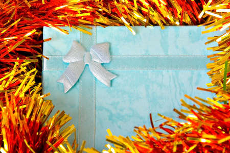 Christmas gift with ribbon on colorful  decorations Stock Photo