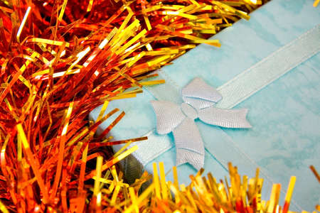 Blue Christmas gift with ribbon on decorations
