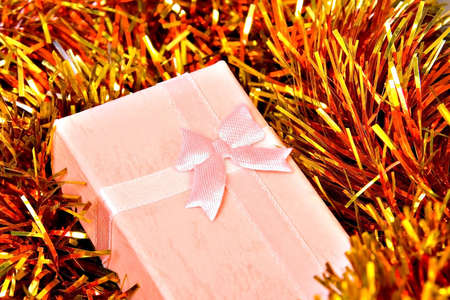 toygift: Christmas gift with ribbon on decorations Stock Photo