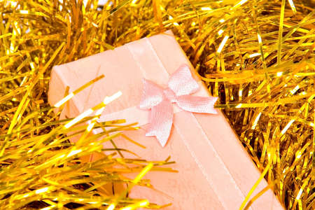 Christmas gift with ribbon on decorations Stock Photo