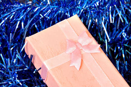 Pink Christmas gift with ribbon on decorations Stock Photo