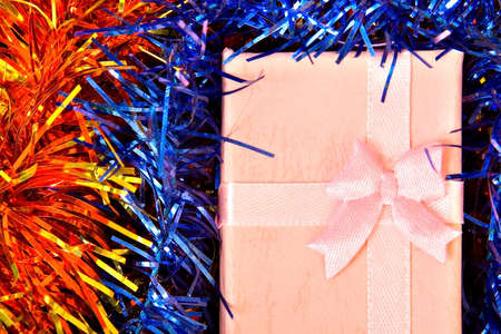 Pink Christmas gift with ribbon on colorful  decorations Stock Photo