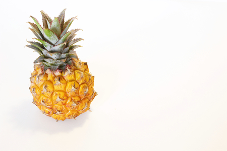 Pineapple on a white background. Pineapple is a plant genus of the bromeliad family,the flesh inside color from almost white to bright yellow, fragrant and juicy.