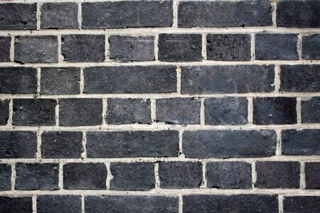 Detail of whitewashed exterior brick wall, for texture and background . Macro detail, industrial pattern.