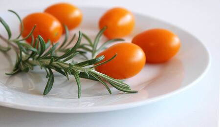 Freshly picked tomatoes in a white vintage ceramic bowl. Concept of diet and healthy food. Selective focus.Food.