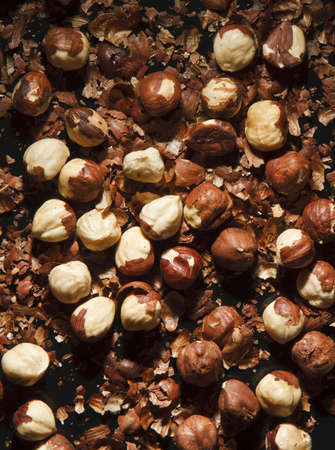 hulled: Hulled hazelnuts laying on the peel