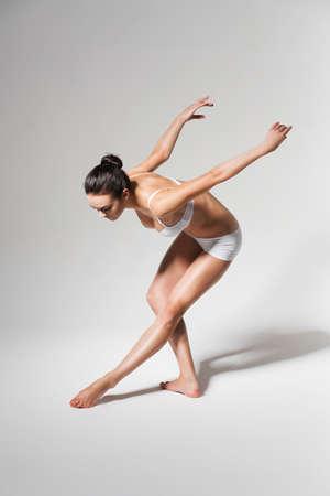 bending down: ballerina bending down to leg