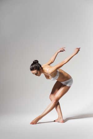 bending down: ballerina bending down Stock Photo