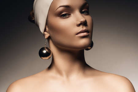 beautiful woman in hat with big earrings photo