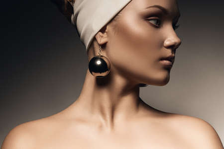 healthy woman with big earrings photo
