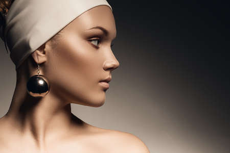 pure woman with big mirror earring photo