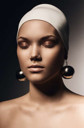 sensual woman in hat with big earrings photo