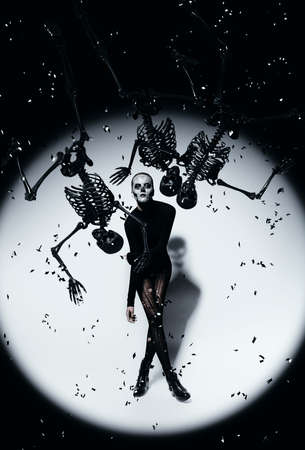 torn stockings: woman in skull make-up and black skeletons