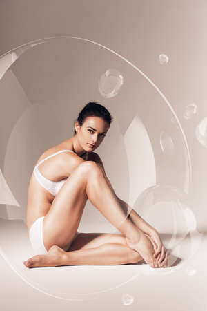 woman bra: sensual woman resting in soap bubble