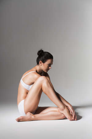 sitting calm woman in white underwear photo
